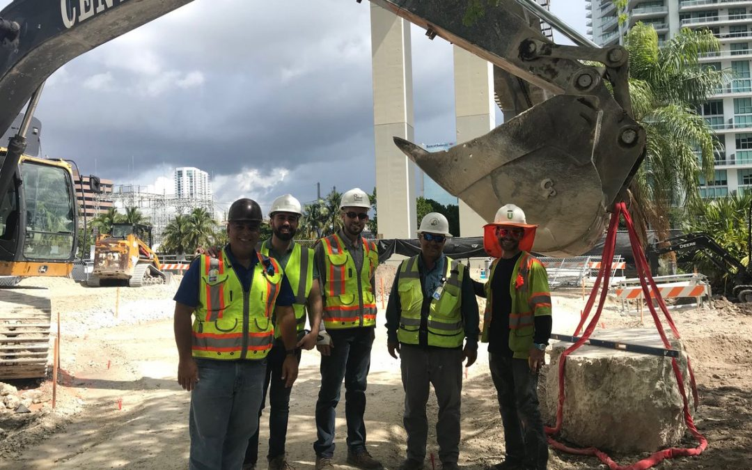 10,000 POUNDS OF PREHISTORIC OOLITE BOULDERS PLACED AT BRICKELL'S UNDERLINE YESTERDAY
